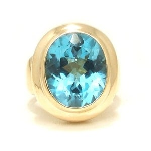 Oval+Blue+Topaz+Yellow+Gold+Cocktail+Ring